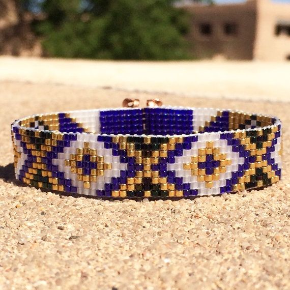 This Sapphire & Gold Bead Loom bracelet was inspired by all the beautiful Native and Latin American patterns I see around me in Albuquerque, New Mexico. As with all my pieces, Ive created it on a bead loom with great care and attention to detail. IMPORTANT NOTE: Please measure your wrist carefully before order placement, to ensure a proper fit. These bracelets are not adjustable.  The beads used in this piece are my favorite - high quality glass Japanese Delicas, much more even and consis...