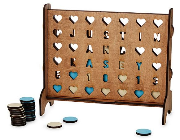 Personalized Hearts Four-Across Game.  The couple who plays together stays together. Challenge your other half to some lighthearted competition with Kasey and Justin Pearson's lovingly crafted four-across game. They carve their handsome, heirloom-quality activity set from birch wood. Amid a field of incised #hearts , up to four lines (seven characters each) can be #personalized with your names, anniversary date, or a sweet message to surprise the one you adore.