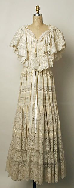 White cotton and lace blouse and skirt, by Giorgio di Sant'Angelo, American, 1974. Worn with embroidered white cotton belt.