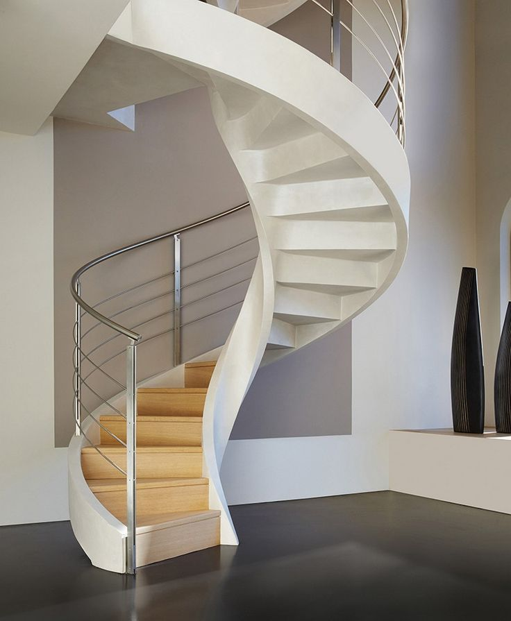 In creating these cement spiral staircases, Rizzi Studio combines a sophisticated design with a perfect technical core
