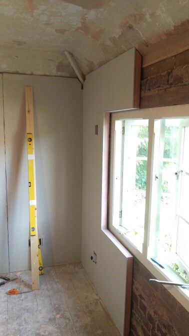 The Kingspan K17 thermal plasterboard is glued into place. The bedroom already feels warmer!