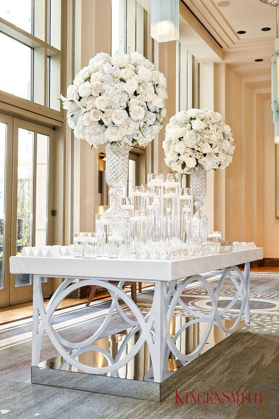 photographer: KingenSmith; White wedding reception centerpiece idea