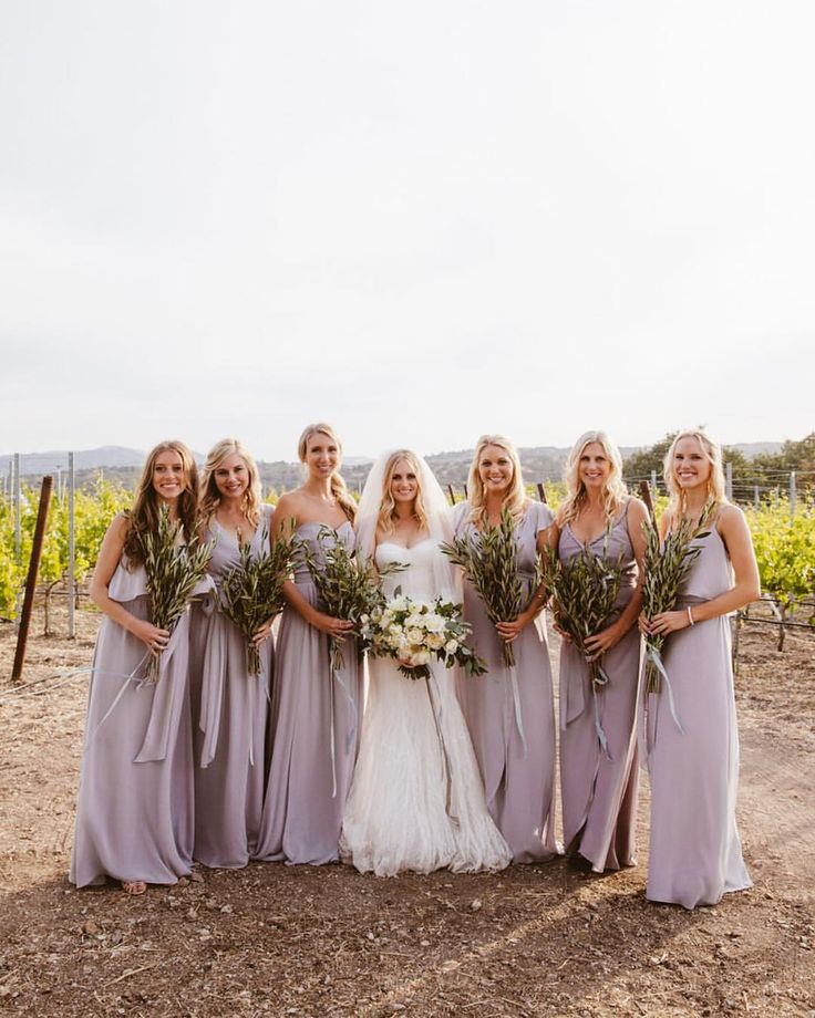 The softest lilac bridesmaid dresses and olive branch bouquets!