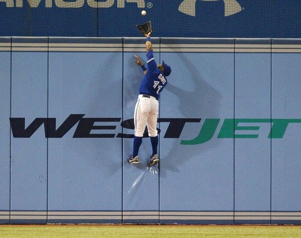 The photo of the night. Toronto Blue Jays left fielder, Rajai Davis scales the 10 foot wall at Rogers Centre