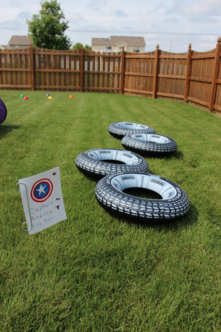 Superhero Training Center - Superhero Obstacle Course - Captain America Tire Run-Inflatable Tires from the Dollar Tree Store. Sign holder from Meijer in the garage sale sign section.
