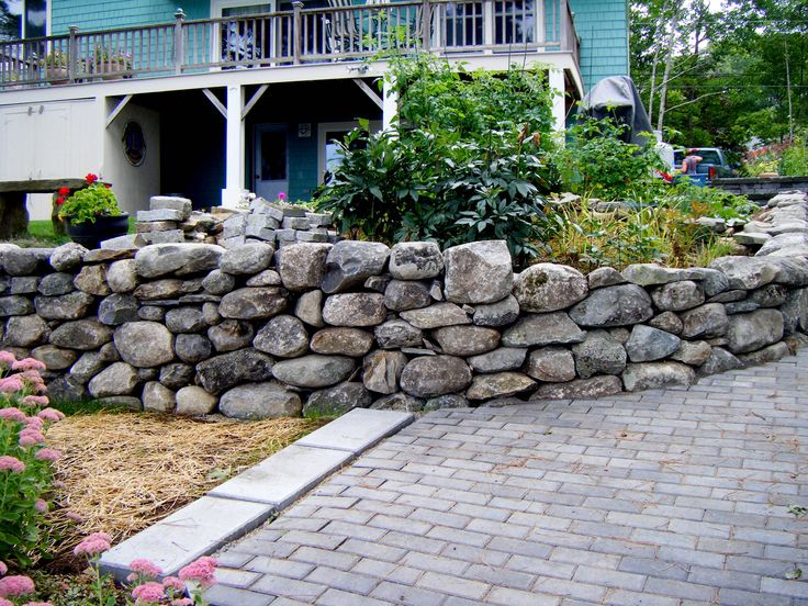 Rock walls for the ages choosing the right stone for Stone landscaping ideas