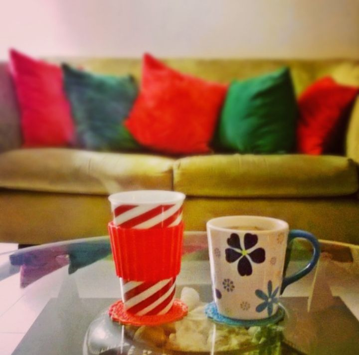 Red, white, green and blue. Mugs and pillow cases in a living room.