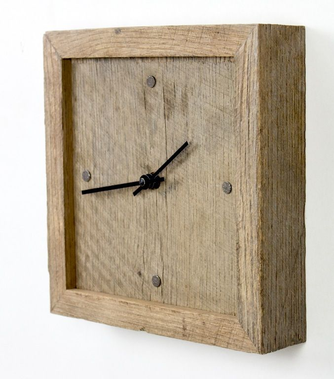 Wall clock of salvaged rough sawn white oak.
