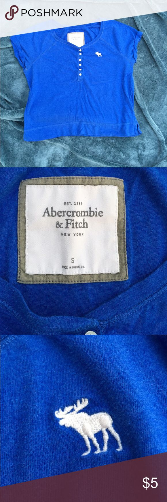 Abercrombie and Fitch mid button cap sleeve tshirt Abercrombie royal blue button down (only midway) cotton blend shirt with cap sleeves. See pics for condition...this was a very well loved shirt but still in very good condition. Priced to sell so someone else can enjoy her!! Abercrombie & Fitch Tops