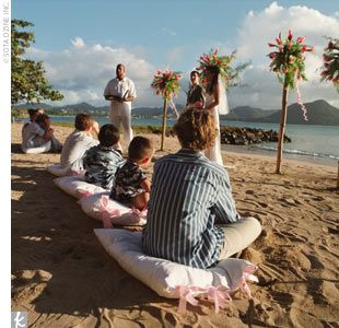 sitting on the beach for the ceremony