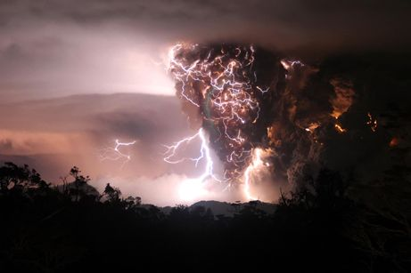 """May 6, 2008After 9,000 years of silence, Chile's Chaitin volcano (pictured on May 3) is erupting with lava, ashand lightning. The mingling of lightning and ash seen above may be a """"dirty thunderstorm."""": Thunderstorms, Natural Disasters, National Geographic, South America, Cloud, Volcanoes, Lightning Storms, Photo, Mothers Natural"""