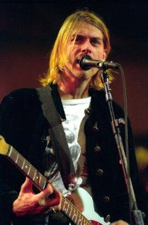 """Kurt Cobain - According to Wikipedia: """"Cobain was [also] a fan of classic rock bands, including Led Zeppelin, AC/DC, Black Sabbath, Aerosmith, Queen, and Kiss."""