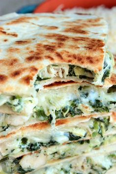 Spinach and Artichoke Chicken Quesadillas - homemade quesadillas stuffed with spinach and artichoke dip, seasoned chicken and melted cheese!