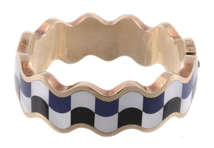 A mother of pearl, onyx and lapis lazuli hinged bangle by Angela Cummings for Tiffany & Co, circa 1980. To be auctioned in Fine Jewellery | 26 March 2015 [Lot 637]