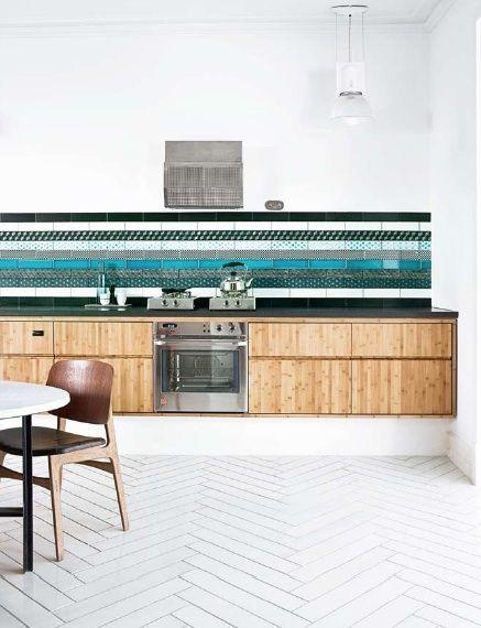 Kitchen with layered tile backsplash and white herringbone pattern tiles