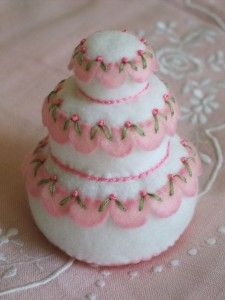 The Wedding Cake Pin Cushion is done in easy hand embroidery and felt.  This makes adorable bridal or baby shower gifts or even fun gifts for birthday parties.