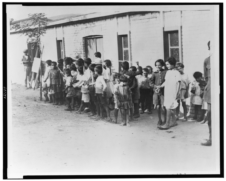 Greek and Armenian refugee children outside barracks near Athens, Greece, in 1923, following their expulsion from Turkey.