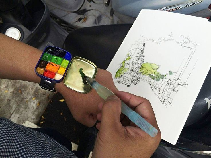 "(via Urban Sketchers Taib\peim a paintbox/palette in a wristband, made from a tin box (approx 2"" x 3"")."