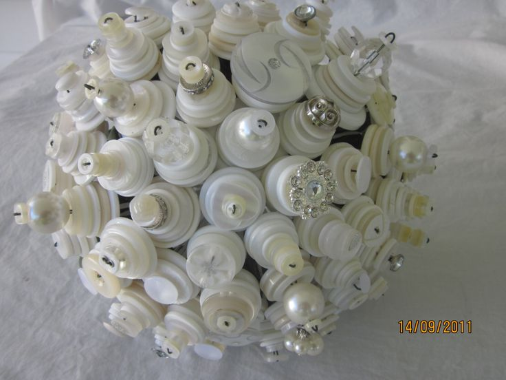 classic white cream ivory with pearls and bling button wedding bouquet by over the top floristry