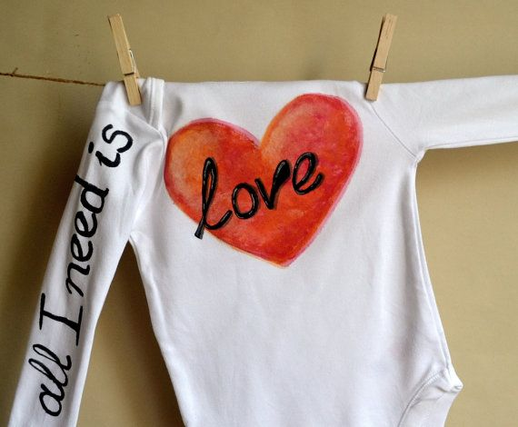 White long sleeve bodysuit for a baby with a big red by maLOVEnia, $20.00