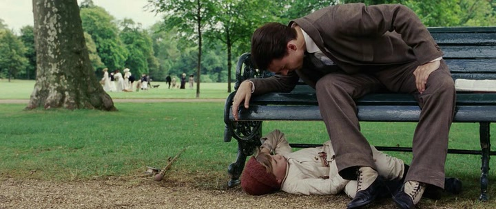 {Johnny Depp as Sir James Mathew Barrie and Freddie Highmore as Peter Llewelyn Davies}