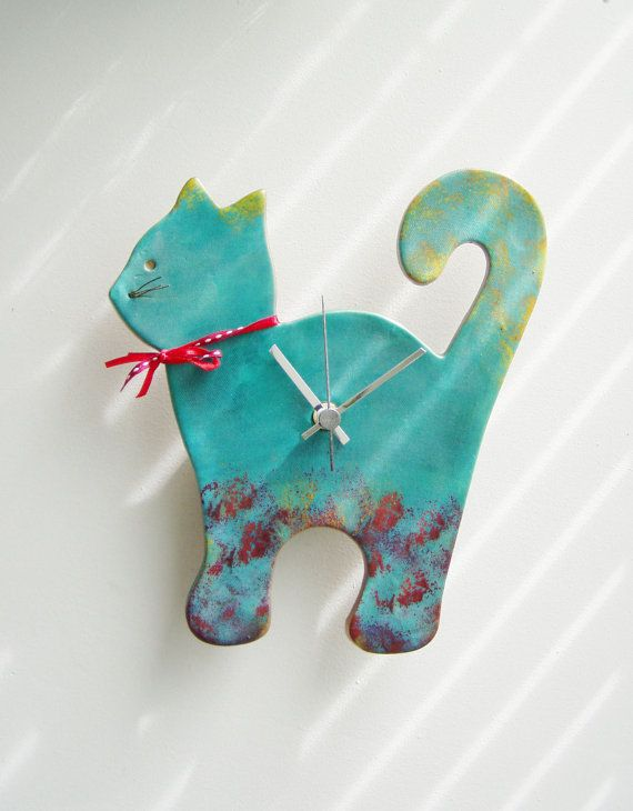 Blue cat wall clock ceramic wall clock of a by AkatosCollectibles, $54.50-https://www.etsy.com/treasury/NjEzMzcwMXwyNzI0MzcyMDg0/lovin-turquoise-and-blues