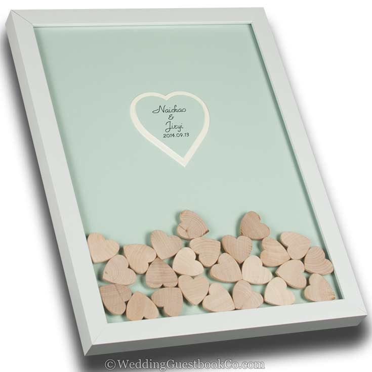 This is a beautiful wedding guest book idea that is personalised. Choose your frame style, frame color, background color, center colors and shape, drop in colors and shapes. By WeddingGuestbookCo.com creative wedding guest book ideas #wedding #weddingidea