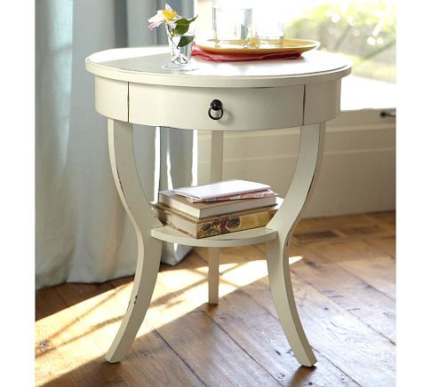 This is going to be the next thing I purchase for my bedroom make over. I love that it is a circle table with a drawer and on legs. Love!