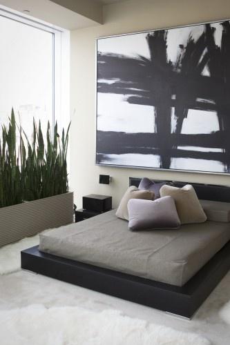 modern + masculine | platform bed + planter + fur rugs + large art