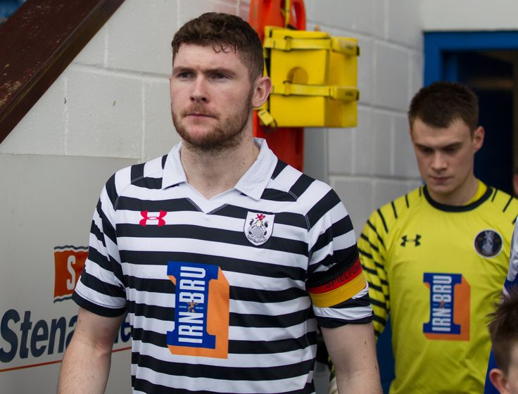 Queen's Park's Ryan McGeever leads his team out before the Ladbrokes League One game between Stranraer and Queen's Park.