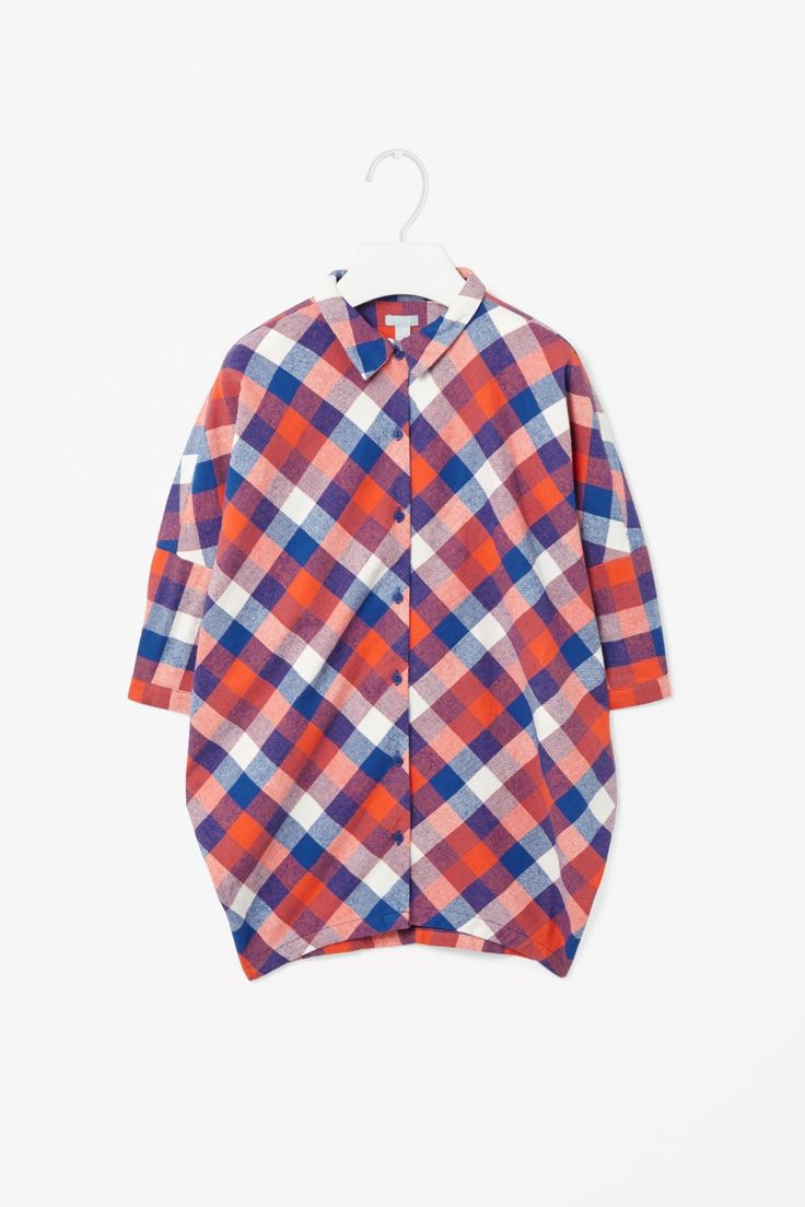 An extra-wide shape for a loose, comfortable fit, this dress is made from brushed cotton flannel with an all-over checked pattern. Designed for everyday wear, it has dropped shoulders and a simple button-up front.