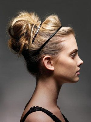 A double headband dresses up a messy bun.