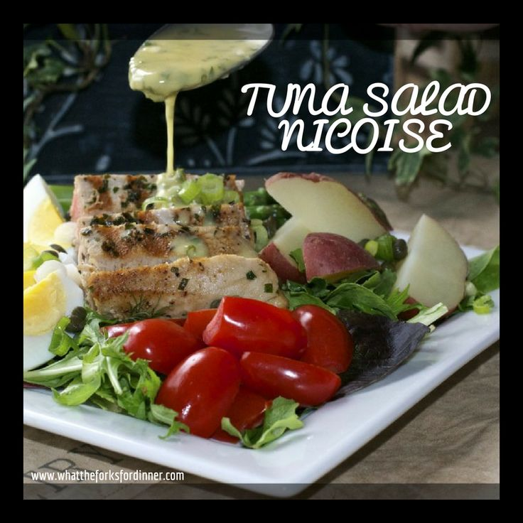 Tuna Salad Nicoise - Take on the classic with grilled tuna, baby red potatoes, hard boiled eggs, and asparagus. Topped with Lemon Mustard Vinaigrette.