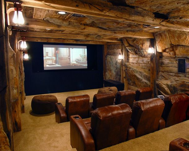 This home theater looks like a literal man cave... the textured walls probably make for interesting acoustics!
