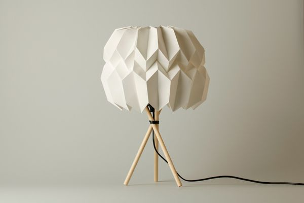 "Table lamp ""Mariko"" made of wood and paper. A self-supporting construction. The base was Origami. Originated from a origami lamp series."