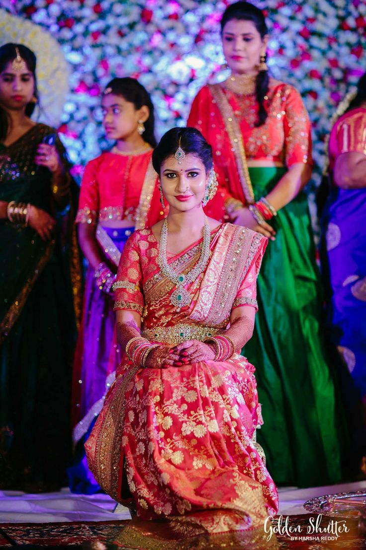 South Indian bride. Diamond Indian bridal jewelry.Temple jewelry. Jhumkis. Red silk kanchipuram sari with contrast pink blouse.braid with fresh jasmine flowers. Tamil bride. Telugu bride. Kannada bride. Hindu bride. Malayalee bride.Kerala bride.South Indian wedding.