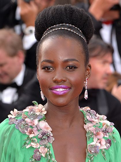 30 Lipstick Ideas to Try Now:  Lupita Nyong'o's shiny orchid lips | allure.com