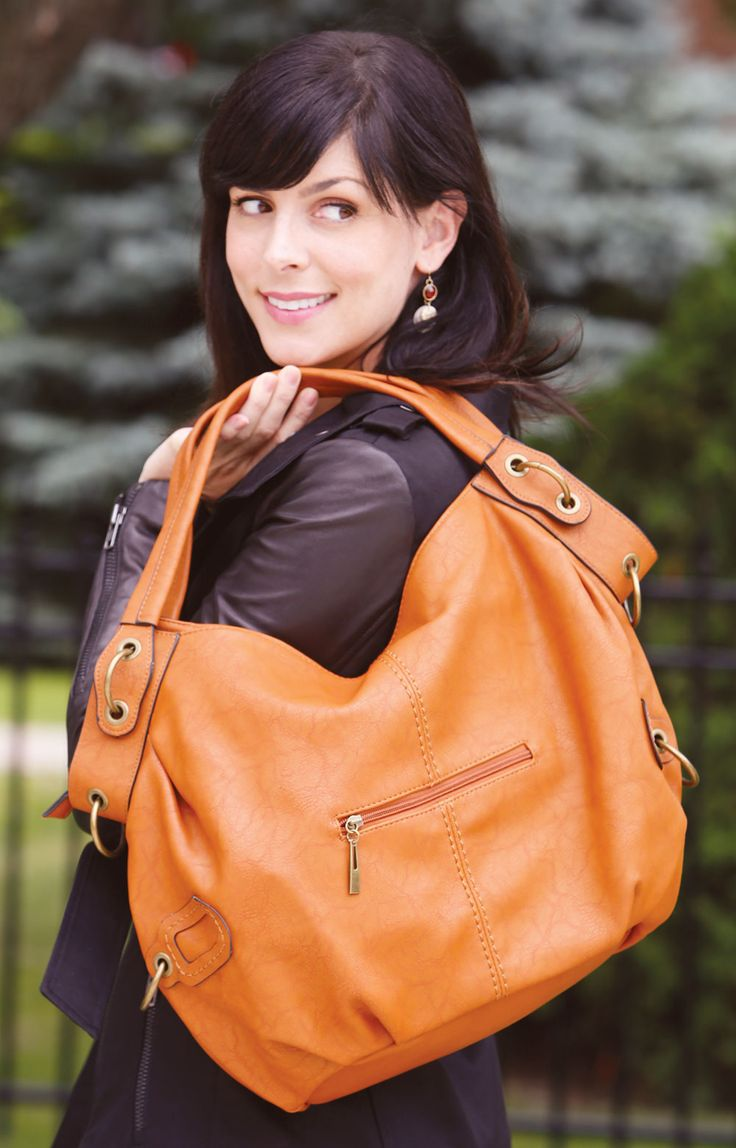 Amelia Handbag - This chic butterscotch handbag features vintage finished golden metal accessories, removable cross-body shoulder strap, a zippered top closure and two zippered outer pockets, as well as convenient open and zippered inner pockets.