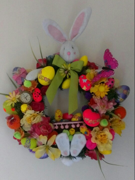 Easter Wreath made with artificial flowers and painted foam eggs.