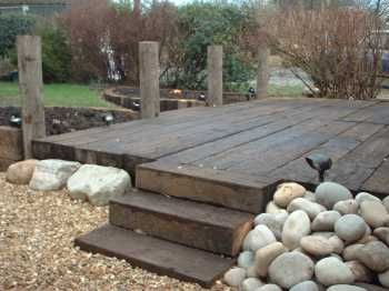 Railway sleeper decking (rustic, and more hard-wearing than normal deck-boards with less maintenance)