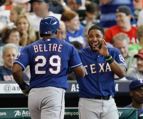 HOUSTON, TX - AUGUST 10: Adrian Beltre #29 of the Texas Rangers is congrtaulated by Elvis Andrus at Minute Maid Park on August 10, 2014 in Houston, Texas. (Photo by Bob Levey/Getty Images)