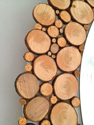 A circular mirror with wood slices all around / by thatsmyletter