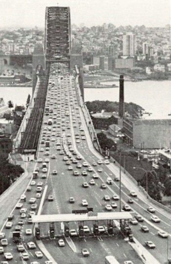 Looking north over the toll booths on the Sydney Harbour Bridge during morning peak hour in 1972.  v@e.