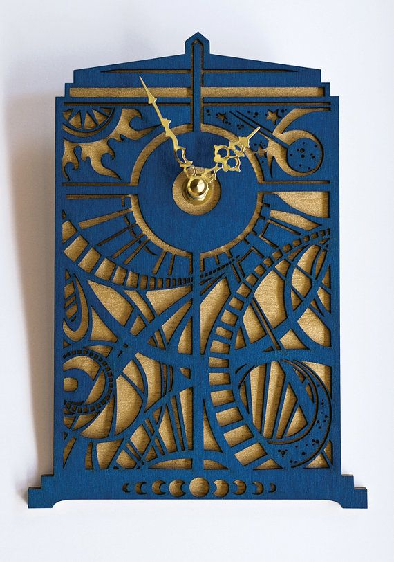 The original Timey Wimey TARDIS wall clock is made specifically for time travelers who are capable of reading a clock without numbers; a special ability, indeed. Our Timey Wimey wall clock is TARDIS Blue with a shimmering metallic gold backing. It is approximately 8 (20cm) tall and 5 (12.7cm) wide. The mini quartz clock movement is powered by one AA battery and has a silent sweep motion (no ticking). Easily mounts on the wall with built in wall hanger. Your Timey Wimey clock will arrive…