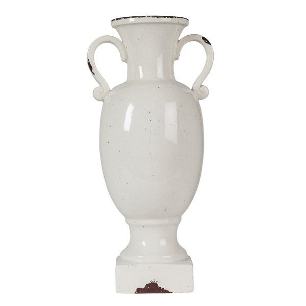 Inspired by a French antique, this charming decorative urn lends flea-market-found appeal to any arrangement. Made from kiln-fired ceramic in a glazed, antique white finish, this classical urn-shaped vase showcases scrolling handles, a regal pedestal base, and a chic crazing effect. To create a pastoral aesthetic in your living room, place a distressed wood console table with an X-frame iron trestle base between two brightly-lit windows dressed in quatrefoil drapes and slubby linen sheers…