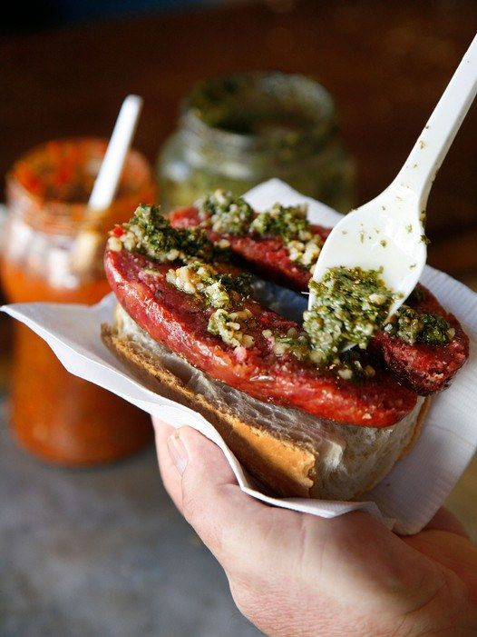 A classic Argentinian street food, the choripán consists of split chorizo on a roll with chimichurri, a sauce of herbs, garlic, olive oil, and vinegar. While sausage on a roll may not sound thrilling, a well-made chimichurri is an incredible delight that makes choripán worth tracking down.