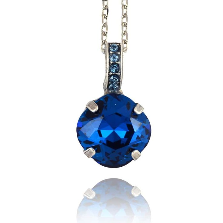 Beautiful Mariana cross necklace, style N-5326/1. Round pendant has faceted round cut Swarovski Crystals. Link chain. Matches jewelry with Mariana Color Way 1069 - Mood Indigo. Contains the following crystal colors: Montana Blue, Denim Necklace is 14 inches long with a 4 inch extender and a lobster claw clasp. Pendant is .75 inches in height. Silver plated with .925 sterling silver over brass. Handmade in Israel. Nickel free and hypoallergenic. Mariana jewelry has a lifetime unconditi...