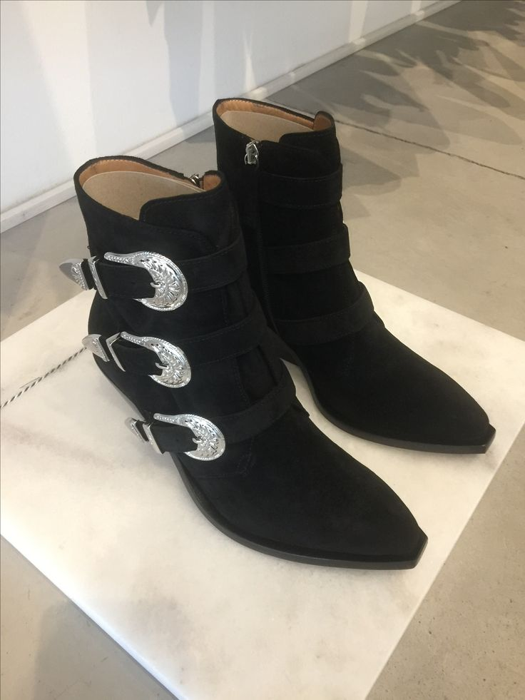 Carla G. Buckled boots