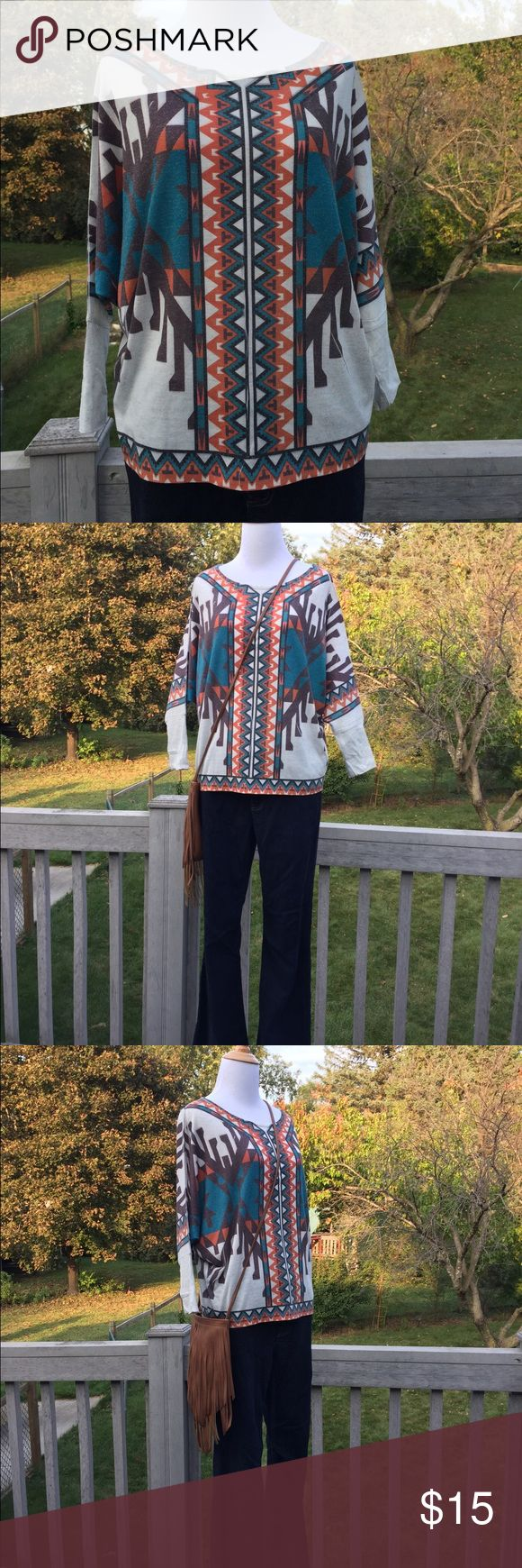 Tribal Shirt This gorgeous tribal-patterned top by Tea N Rose is a comfy blend of 85% polyester and 15% linen. The teal, orange, brown and white colors are perfect for fall! The batwing sleeves are 3/4 length. Tea N Rose Tops Tunics