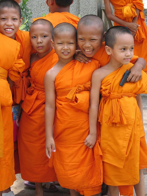 Monks. Thailand  Is that a play gun in a monk boy's hand?  http://islandinfokohsamui.com/